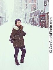 Young asian tourist woman in Winter, Sapporo - Japan.