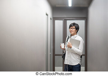 Young Asian university student in college