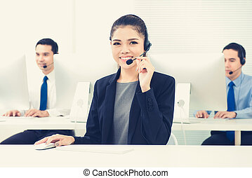 Young Asian woman as an operator working in call center