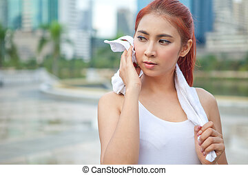 woman athlete wiping her towel