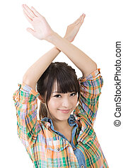 Young asian woman crossed hands overhead. Studio shot on the...