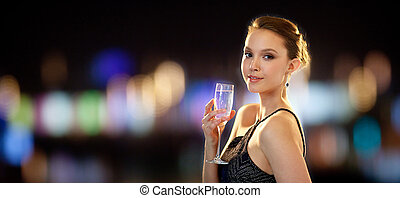 young asian woman drinking champagne at party