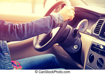 young asian woman driver driving car
