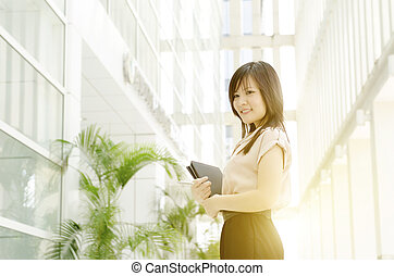 Young Asian woman executive at office