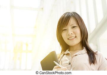 Young Asian woman executive