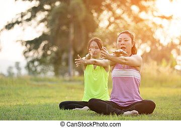 Young asian woman exercising in park.