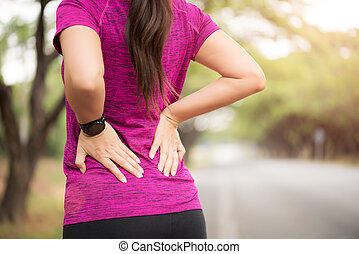 Young asian woman feel pain on her back and hip while exercising, health care concept.
