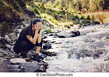 Young Asian woman hiker by the river, outdoors activities