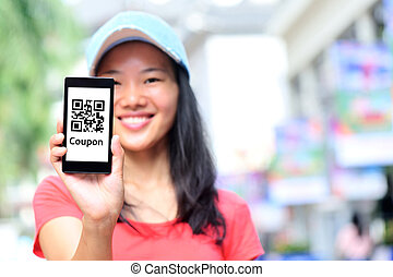 young asian woman hold smart phone at shopping street