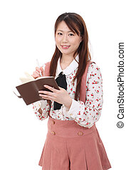 Young asian woman holding notebook