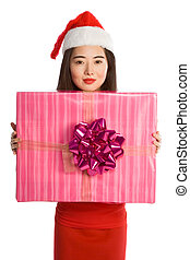 Young Asian woman in Christmas hat with huge gift
