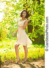 Young asian woman in light dress