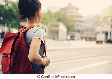 young asian woman on city street