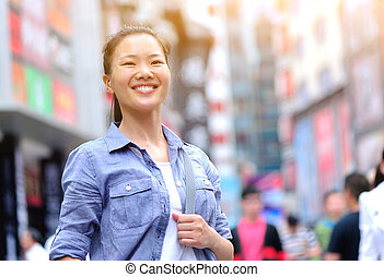 young asian woman on street