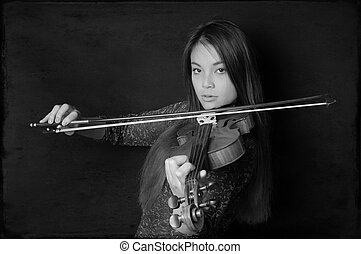young asian woman playing violin