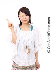 Young asian woman pointing - Young asian pretty woman...