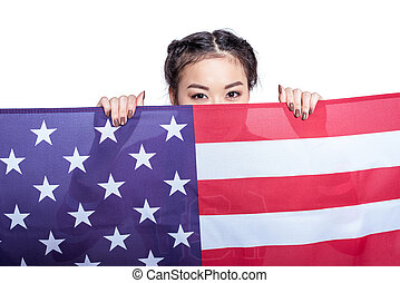 Young asian woman posing with american flag isolated on white