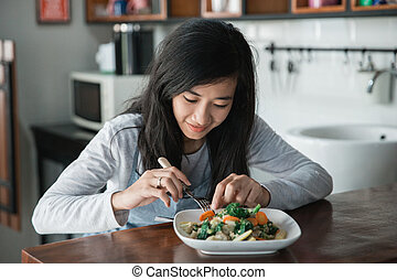 asian woman preparing food