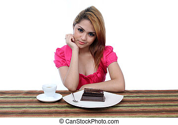 Young asian woman ready to eat a piece of cake