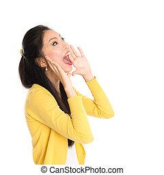 Young Asian woman shouting