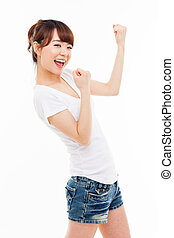 Young Asian woman showing fist isolated on white background.