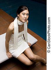 Asian Woman Sitting Down