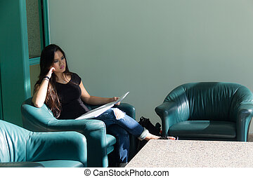 Young asian woman sitting pauses to think while reading. Studying to prepare for a school exam