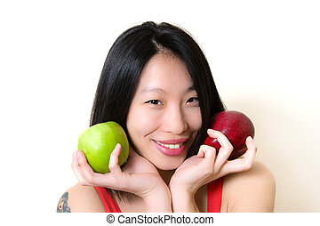 Young asian woman smiling with green and red apples