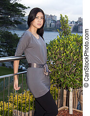 Young Asian Woman Standing Outdoors