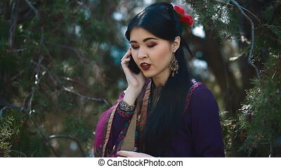 Young asian woman talk by phone - Young asian woman in...