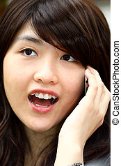 Young asian woman talking on phone