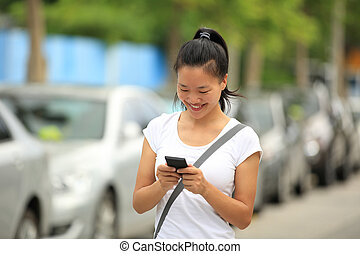 young asian woman use her cellphone