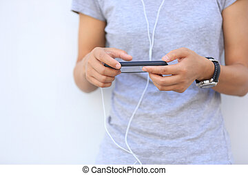 young asian woman use smartphone at city