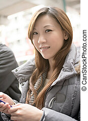 Young Asian woman using cellphone
