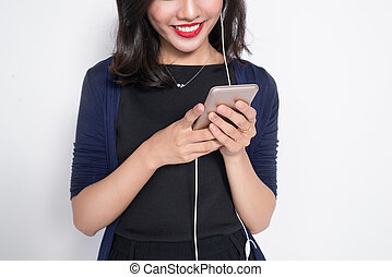 Young asian woman using smartphone isolated on white.