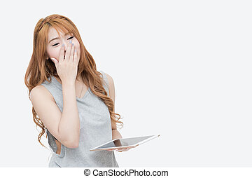 young asian woman using tablet