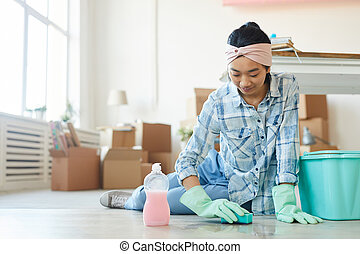 Young Asian Woman Washing Floor