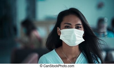 young Asian woman wearing a medicine mask