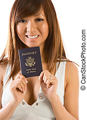 Friendly Japanese or Chinese female smiling and holding her new US passport