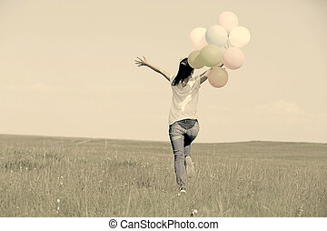 young asian woman with balloons