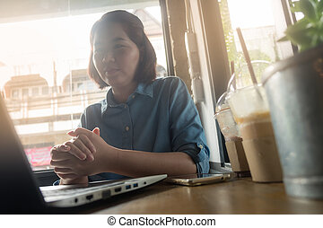 Young Asian woman working in coffee shop