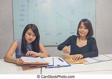 Asian women working in the meeting room