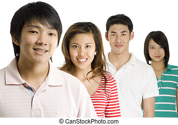Young Asians - Four young asian men and women standing in a...