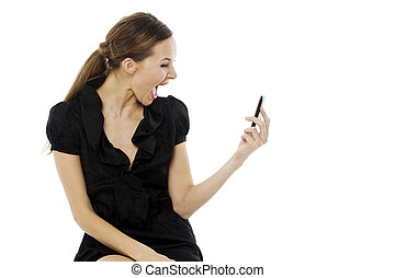 Young astonished woman holding a cellphone on white background studio