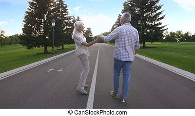 Young at heart couple on a cheerful walk outdoors