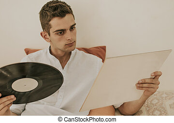 young at home with the vintage music album