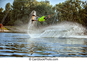 Young athlete is a wakeboarder.