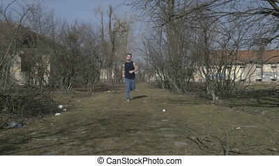 Young athlete jogging in an abandoned place