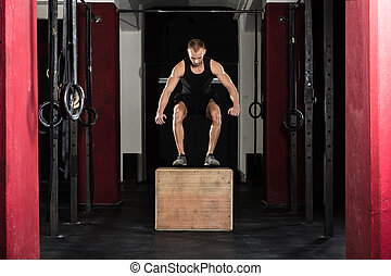 Man Doing A Box Jump Exercise