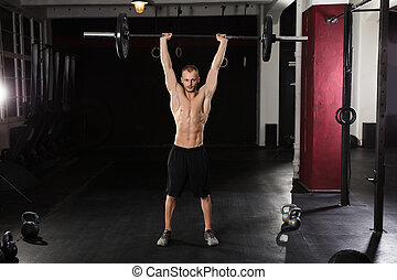 Young Athlete Man Lifting Barbell